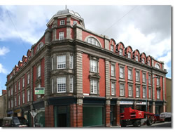 Conversion of the top three floors to living space (30 residential units) and renewal of all shop fronts.
